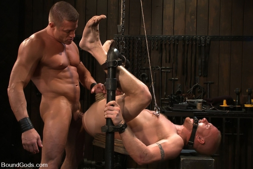 Male bodybuilder dominates and puts stud in gay bondage